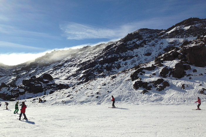 skiers on snowy mountain in New Zealand in winter