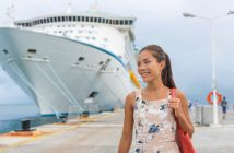 Cruise ship passenger leaving boat for shore excursion in harbour. Asian woman tourist spending a day in port of call of Caribbean travel destination.