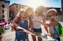 Kids on holiday checking tourist information