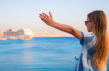 girl looking at cruise ship